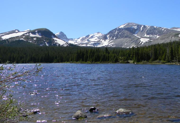 Photo of Brainard Lake in August with snow-capped peaks in the background