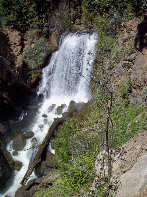 Water pours down Mill Creek Falls over 100 feet.