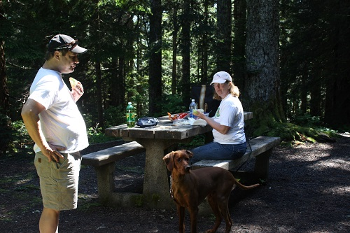 Hikers enjoying a picnic.