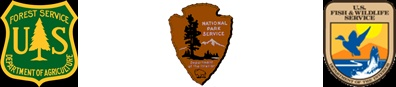 The official emblems of the Forest Service, National Park Service and Fish & Wildlife Service