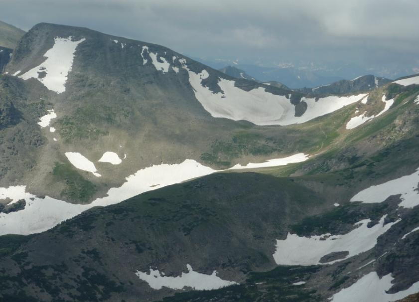 Photo of Buchanan Pass showing stormy skies and Sawtooth Mountain