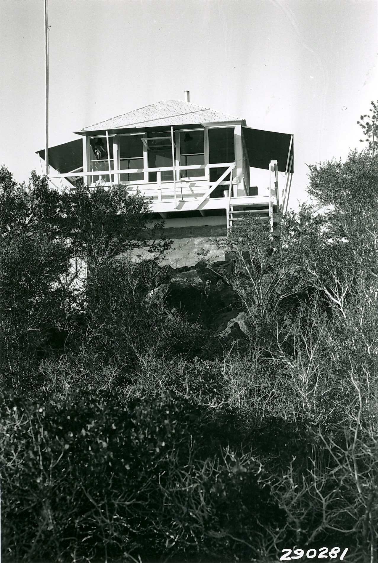 An old wooden lookout on a rock base.