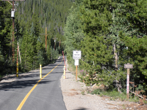 Bakerville-Loveland bike path. 'No Motor Vehicles' and 'Baker/Loveland Trail No. 60' signs posted.