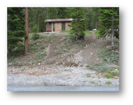 Trails leading to restrooms that have been created by visitors and causing more soil erosion.