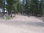 Photo shows a very spacious campsite at Columbine campground. Site has picnic tables fire grates.