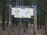 A visitor information sign. Information includes Leave No Trace, Safety, and Regulations.