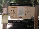 A visitor information sign displays at the beginning of Echo Lake trailhead.