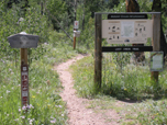 Visitor information, trail and permit signs display at the beginning of Lost Creek Trail.