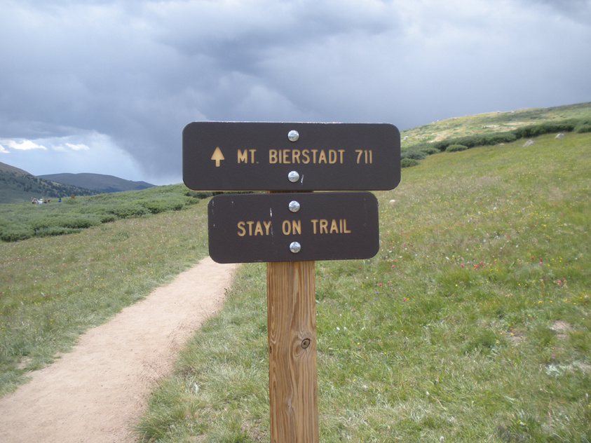 """Mt. Bierstadt 711"" and ""Stay On Trail"" signs at the beginning of Mount Bierstadt trail."