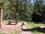 One of the campsites at West Chicago Creek Campground. Amenities are in the background.
