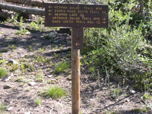 A photo of a sign, including Watrous Gulch Trail, letting hikers know where trails will lead them.
