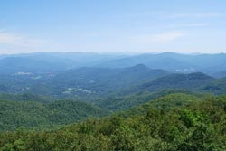 Photo of the mountains from Brasstown Bald covered with the green summer forest