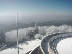 Photo of snow on the top of Brasstonw Bald from the tower at the observation deck