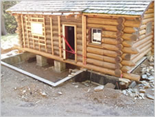 Photo of the IPNF Avery Creek cabin during restoration.