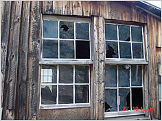 Photo of broken windows on a heritage site on the Helena NF.