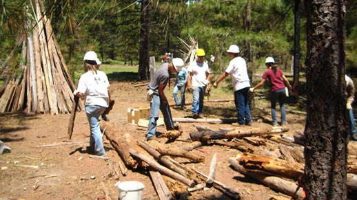 A crew removes an old corral near McCloud