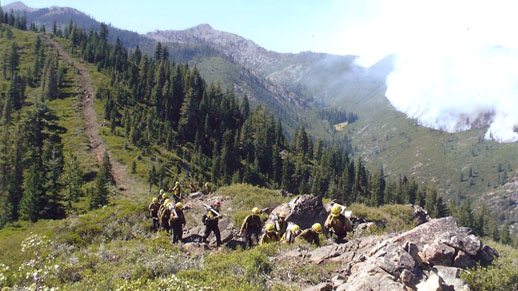 HotShot Crew hiking up hill after completion of cutting handline.