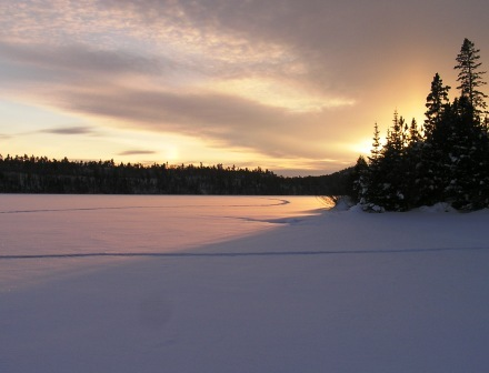 Sunrise over a winter lake