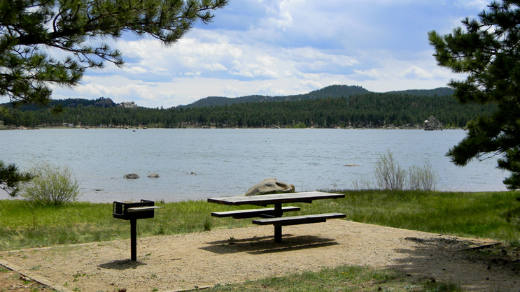 One of the picnic sites at Dowdy Lake. Each site contains a table and grill.