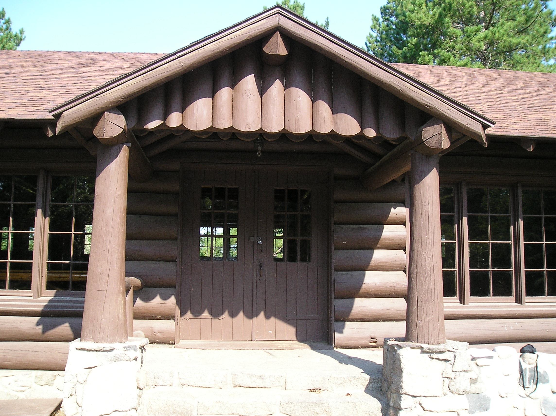 Front entry door of log pavilion.