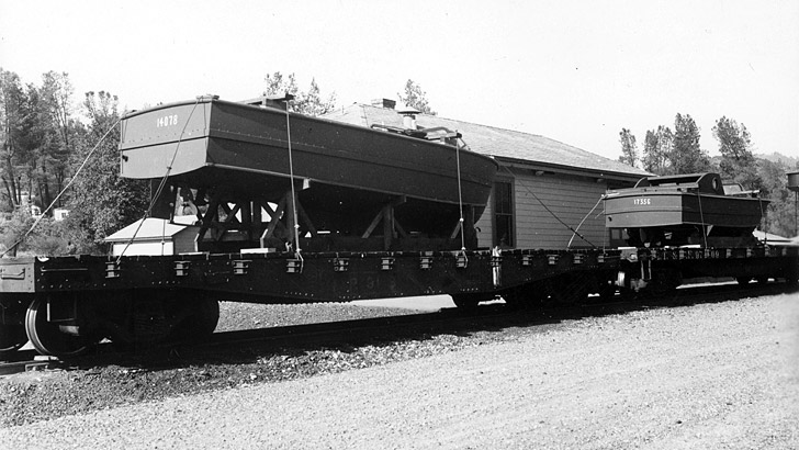Two large boats are shown on railcars for use on Shasta Lake in 1945