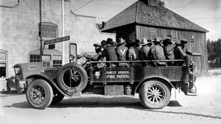 An old truck transports a Forest Service fire patrol in the 1920s