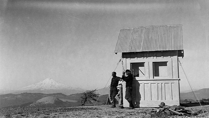 Little Mt. Hoffman lookout in 1922. It was a very small building. Photo shows two people