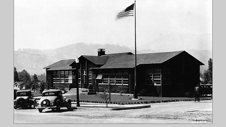 The Shasta NF Supervisors Office in 1938 with old style cars parked in front