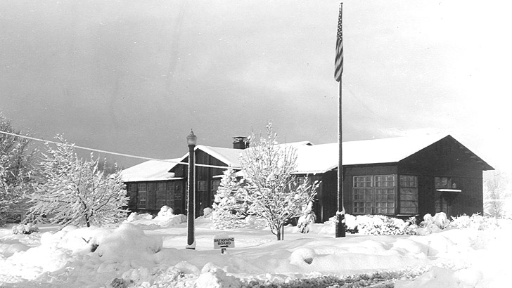 Shasta NF Supervisors Office during WW2 and a snow storm. Sign in front says Rationing Board