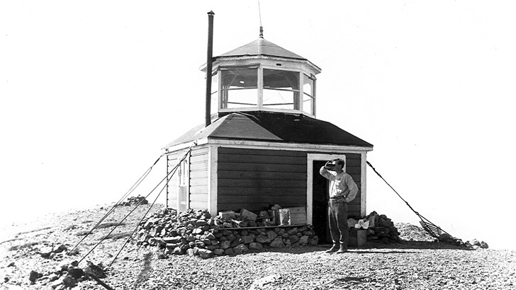 Mt. Eddy Lookout in 1914. The building reminds this observer of a lighthouse. 1 person is visible