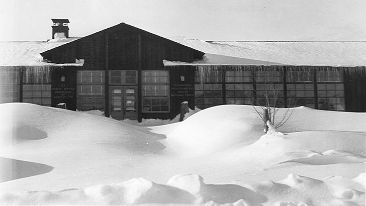 Shasta NF Supervisors Office during a snow storm about 1938. Icicles and thick snow are present