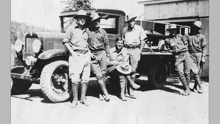 1933. Six men pose beside a fire truck. They are the Hayfork District Fire Suppression crew