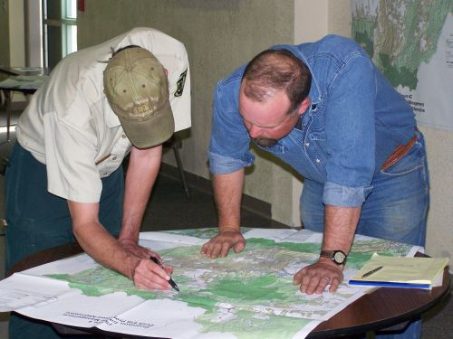 Two men looking at a map