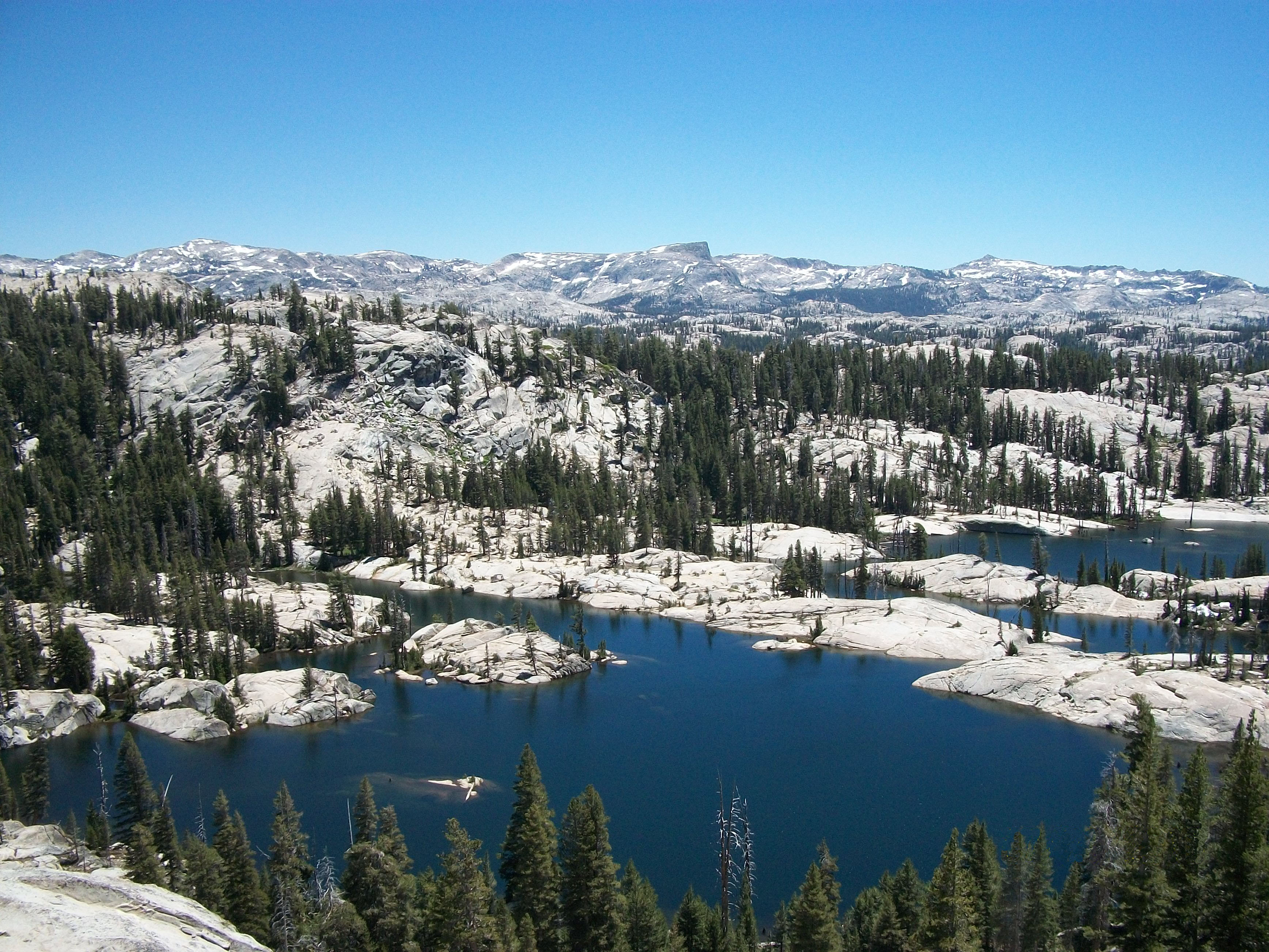A snowy view of Upper Bucks Lake which is a scenic granite lake surrounded by forest.