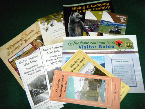 A photo showing all the maps you can buy of the Shoshone National Forest