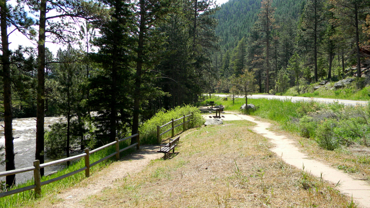 Site is located along the Cache La Poudre River. Bench, picnic table and fire grate are available.