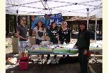 Color photo of Generation Green members at the seed planting booth during the Earth Day event.