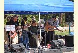 Color photo of live music act Acoustic Tom Foolery who performed during the Earth Day event.