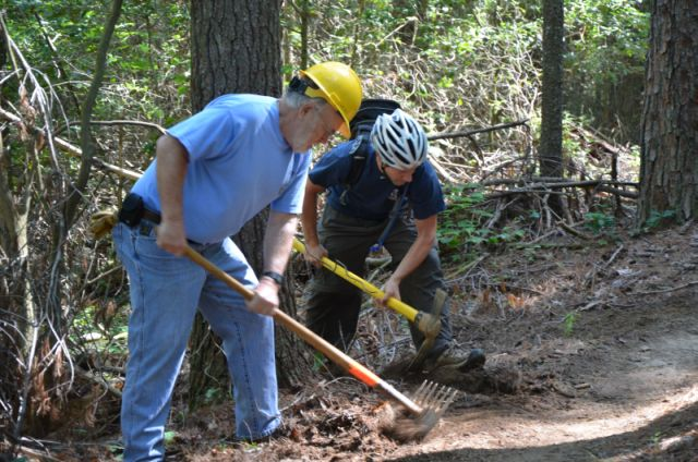 Volunteers maintaining a trail