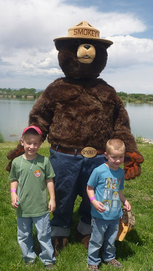 Smokey posed with 2 little boys