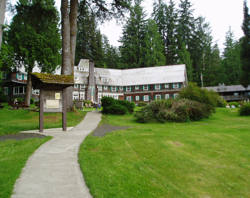 Quinault Lodge lawn and Quinault Loop Trail information board.