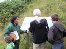 Field Ranger along a trail at the Cape talking to visitors by interpretive sign