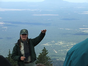 Ranger on top of San Francisco Peaks giving a talk.