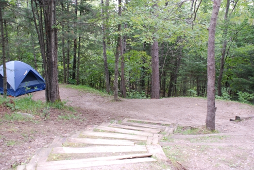 Campsite at the Fenske Lake Campground with natural steps descending to the tent area.