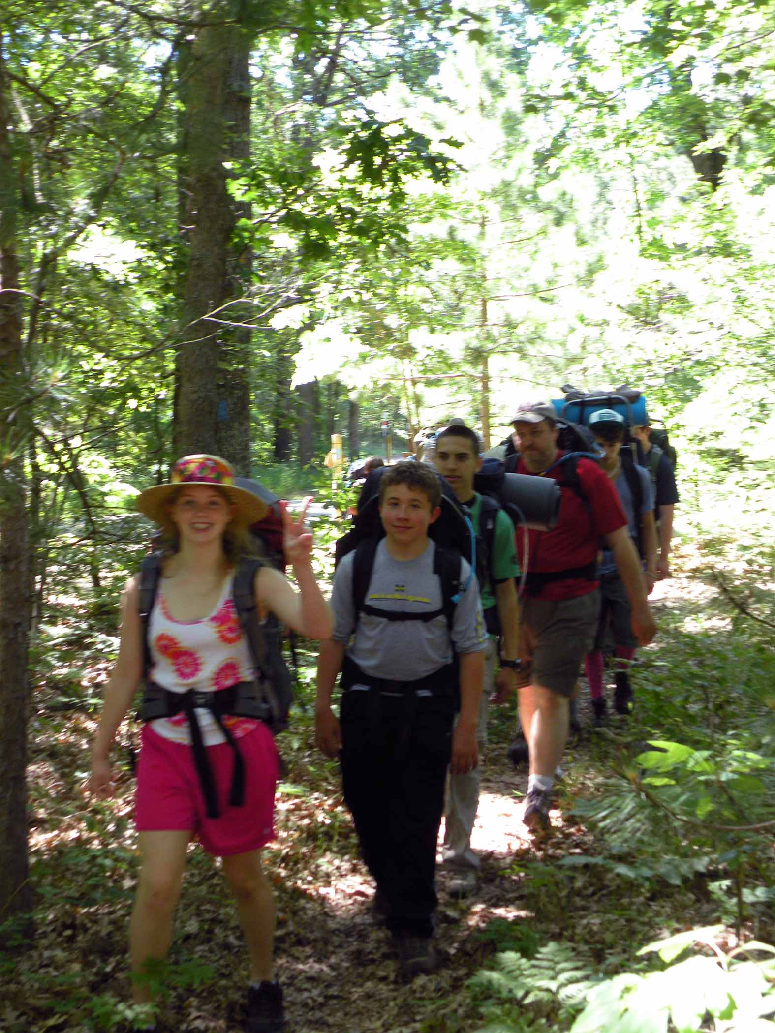 A group of scouts hiking the trail near Nichols Lake.