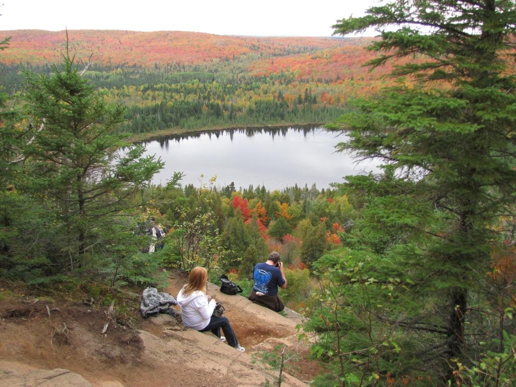 A couple enjoys the view from the Oberg Mt Trail in the fall.