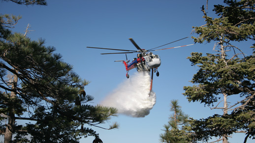 Type 1 Helitanker drops on a wildland fire East of Green Valley Lake.