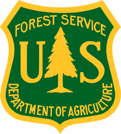 The Forest Service green and yellow insignia