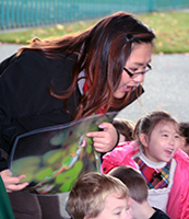 Kathy Vue talks with students at Horizon Elementary about the pacific tree frog that lives in their local wetland. Story by Kathy Vue.