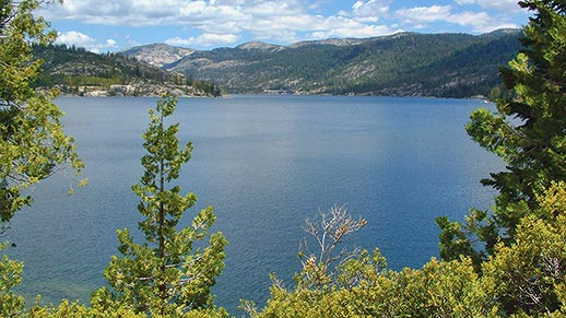 Bear reservoir on the Eldorado surrounded by trees and showing wooded hillsides.